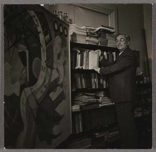 Wassily Kandinsky in his studio in Neuilly-sur-Seine in front of his library