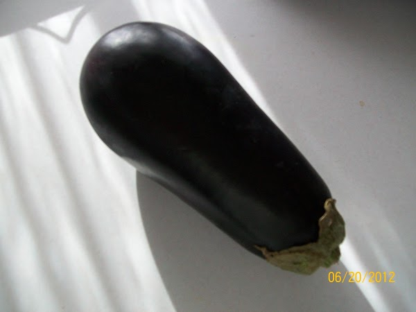 Wash and cut eggplant into small bite size pieces, and soak in salted water...