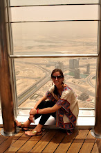 Photo: Autumn Hilsinger sits in front of an observation window atop the Burj Khalifa, the tallest building in the world, in Dubai.