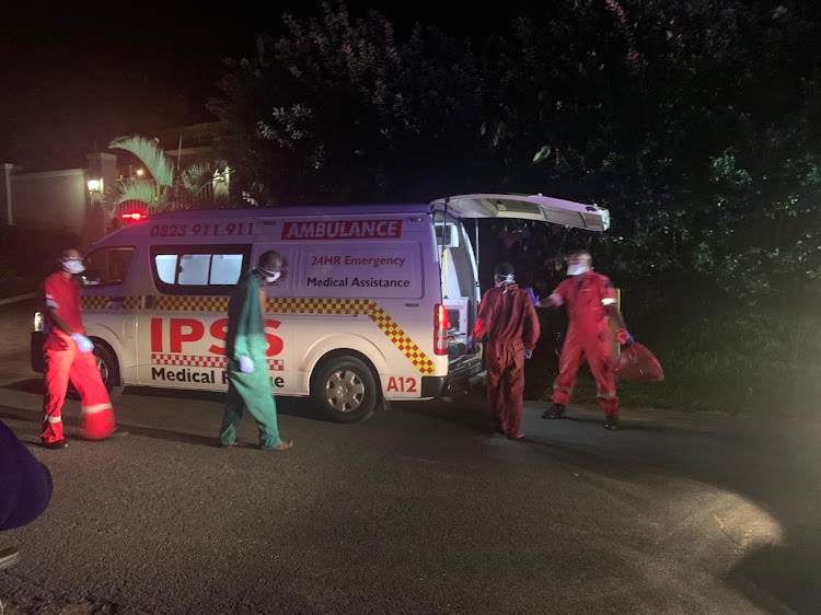 Tanzanian stowaways, in green and red between IPSS medical staff, make their way to the ambulance after being rescued offshore of Zinkwazi beach, KZN.