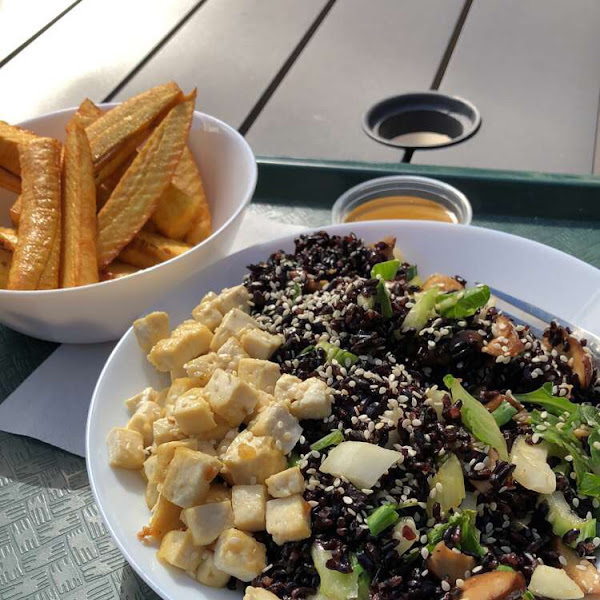 Black rice shiitake mushrooms bok choy and tofu. Plantain fries on the side