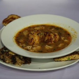 Bayou Stew with Fried Seafood Cakes and Crawfish Bread.