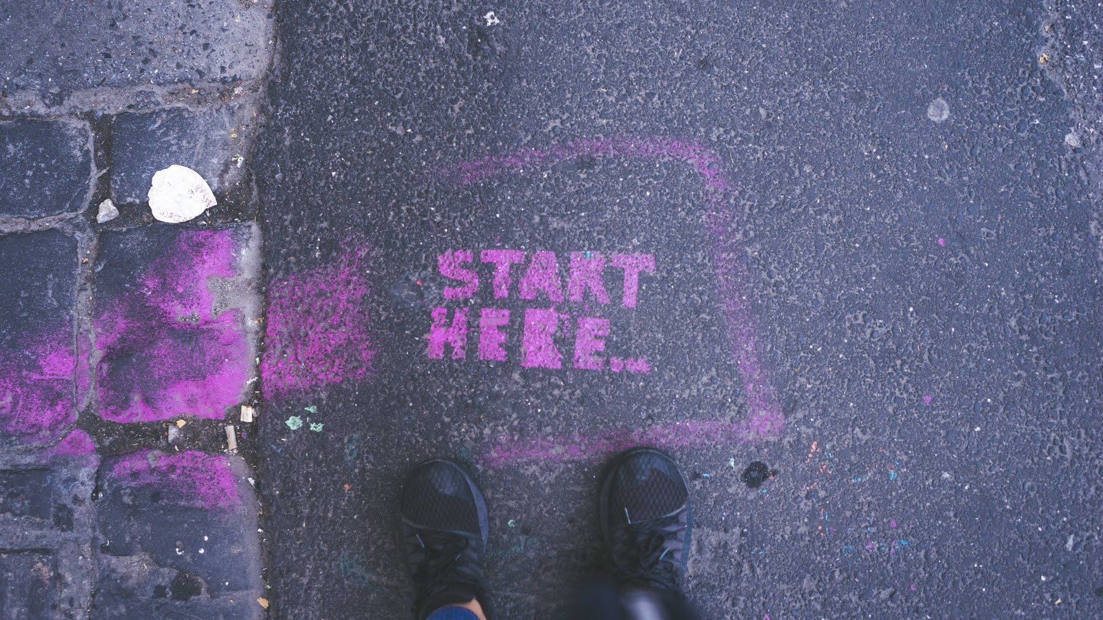 """Start here"" written on the ground"