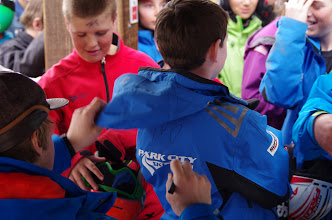 Photo: Ted signs a Park City Ski Team member's jacket.
