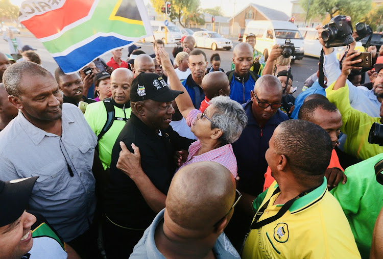 President Cyril Ramaphosa gets a warm welcome in Athlone where led members of the public on a morning walk from Gugulethu. FILE PHOTO.