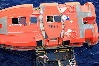 Photo: Life boats are used as tender boats.
