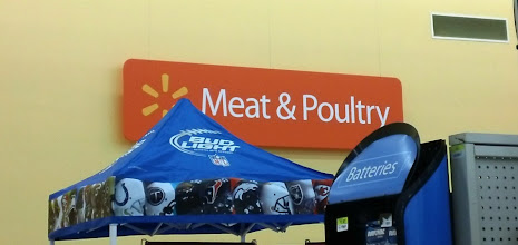 Photo: My mother-in-law was baby-sitting my daughter and had called us to pick her up because she needed to go somewhere. So I knew this would be a quicker than usual shopping trip for us. We immediately found the Meat & Poultry section and headed there. The Walmart had a few tall displays that slightly covered the signage for shoppers who were up close.