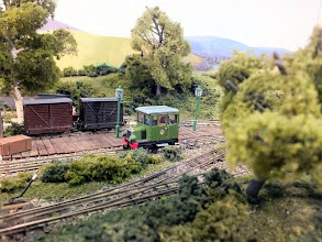 Photo: 020 By request of the layout owner, a certain little green railcar descended by hand-in-the-sky to visit Bottle Kiln Lane for a photo opportunity – and log yet another layout visit for the Roving Reporter! .