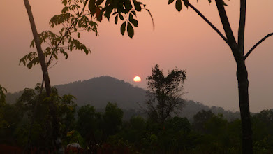 Photo: sun sets over the western hill - one of the 7 hills surrounding the abode