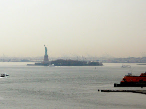 Photo: Another view of the Statue of Liberty with a Circle Line ferry on its way there. http://www.circlelinedowntown.com/statue-Ferry.asp