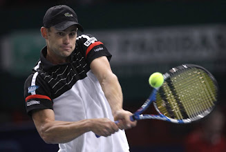 Photo: US tennis player Andy Roddick returns the ball to Julien benneteau of France during their match in the Paris Tennis Masters tournament, Tuesday, Nov.8, 2011, in Paris, France. (AP Photo/Lionel Cironneau)