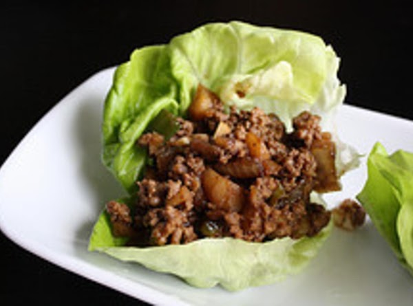 Pile the meat mixture into the center of each lettuce leaf. Wrap the lettuce...