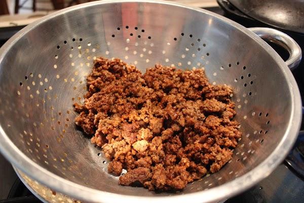 Brown hamburger, drain then add taco seasoning and simmer.