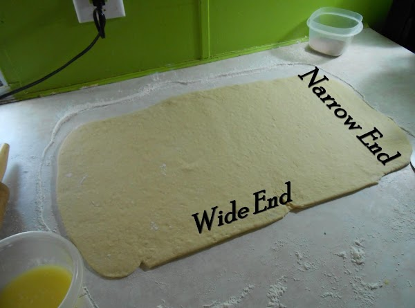 Starting at narrow end (for flatter, wider rolls) or at long wider end (for...