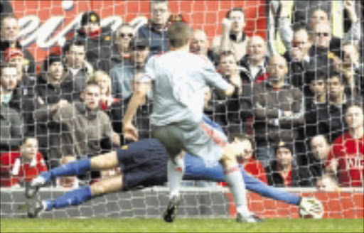 Manchester United's Edwin van der Sar, bottom, fails to save a penalty from  Liverpool's Steven Gerrard during their English Premier League soccer match at Old Trafford Stadium, Manchester, England, Saturday March 14, 2009. (AP Photo/Jon Super) ** NO INTERNET/MOBILE USAGE WITHOUT FOOTBALL ASSOCIATION PREMIER LEAGUE (FAPL) LICENCE. CALL +44 (0) 20 7864 9121 or EMAIL info@football-dataco.com FOR DETAILS **