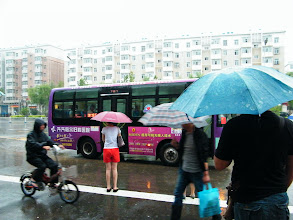 Photo: journey hometown in summer 2013 shakes doubts and plows hope: the tour starts in a raining day in Qiqihar. here benzrad, the proud dad, launched from his dorm to fetch his son for train 2 hours later, at a bus stop.