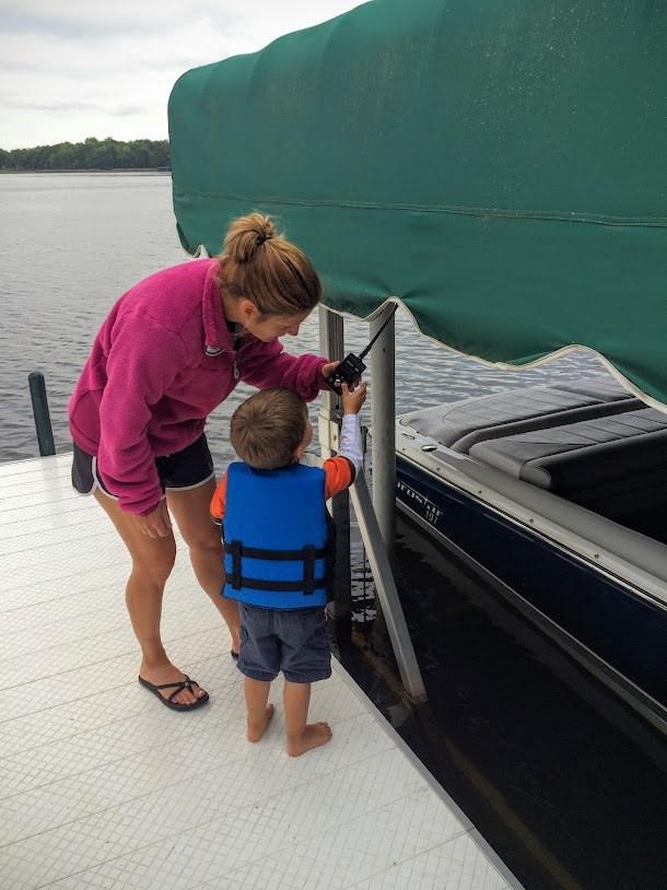 Stacy showing Toby how to put the boat in the water.