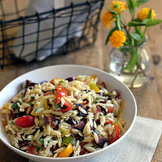 Lemony Orzo Pasta Salad with Tomatoes, Olives and Bacon.
