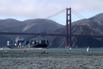 Photo: Gigantic cargo ships (some nearly 300m or 1000ft long) would come into the bay.  I felt nervous for the small Laser sailors in their 13ft boats who looked like little dots in comparison to the big freighters.