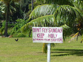 Photo: These islands are very religious and it's actually illegal to do some activities on Sundays (fishing trips, etc.).  It's not stopping the airlines from pumping tourtists in on the Holy Day, though, and it's obviously upsetting the locals because we saw signs like this all over the place (that chicken had better not be laying eggs on a Sunday!).
