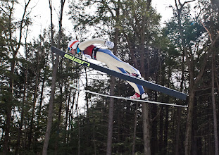 Photo: Local skier Spencer Knickerbocker flies through the air while competing in the FIS Cup at the Harris Hill Ski Jump in Brattleboro.(Zachary P. Stephens/Brattleboro Reformer)