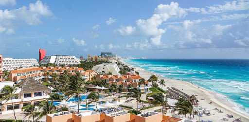 Turquoise waters finger the sun-dappled waterfront of Cancun, Mexico.