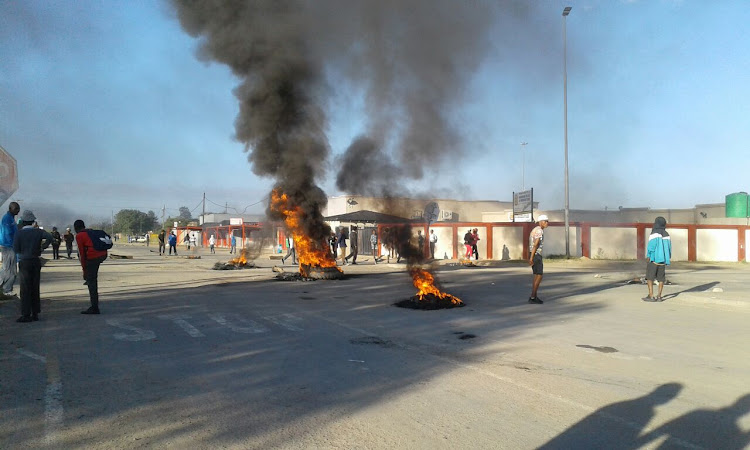 North West protesters burn tyres as they call for premier Supra Mahumapelo to step down.