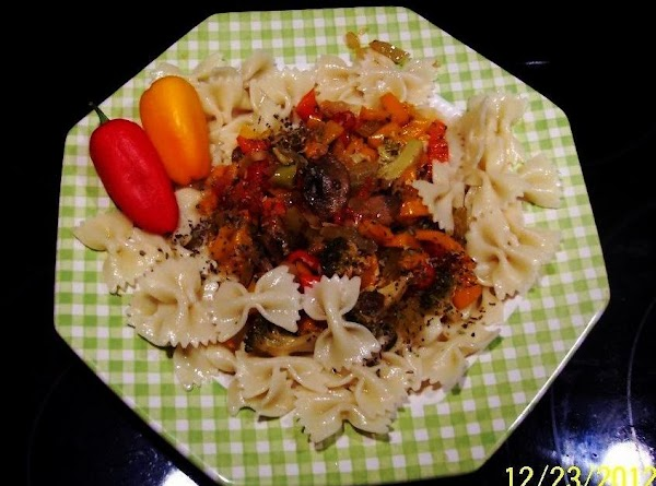 Remove vegetables from skillet and place on top a bed of farfalle. Drizzel with balsamic...
