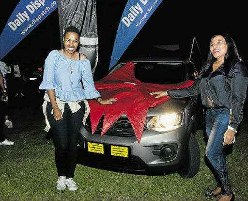 SPECIAL MOMENT: Motor car winner Chwayita Gwadana, left, poses with Gogo Manqoyi from London Roots Picture: DIGITAL LIFESTYLE