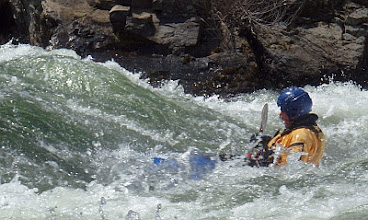Photo: Surfing at First Threat Rapid.
