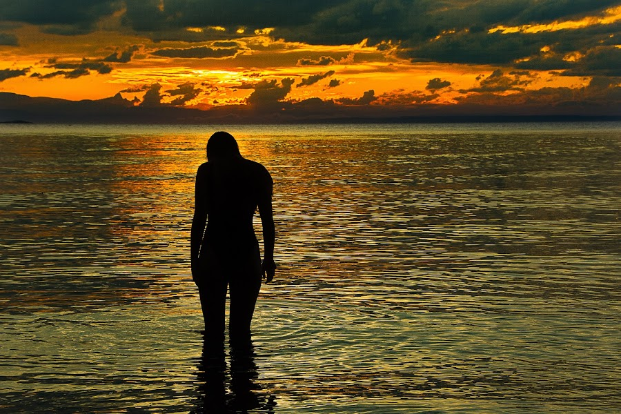 Sad on the Beach by Gary Dobbin - People Portraits of Women ( reflection, sunset, sad, silhouette, pensive, light )