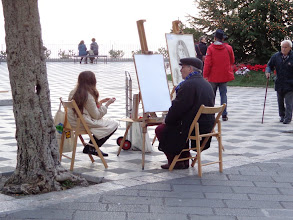 Photo: Argentinian street artist at work on piazza Sant'Agostino