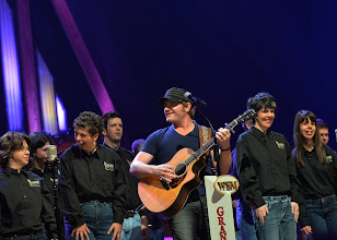 Photo: NASHVILLE, TN - JUNE 28:  Singer/Songwriter Jerrod Niemann (with guitar) is joined onstage by the ACM Lifting Lives Music Campers during ACM Lifting Lives Music Camp - Grand Ole Opry Performance at The Grand Ole Opry on June 28, 2013 in Nashville, Tennessee.  (Photo by Rick Diamond/Getty Images for ACM)