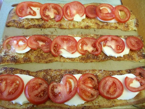 Arrange tomato and cheese slices in overlapping rows on baked crusts. Return to oven;...