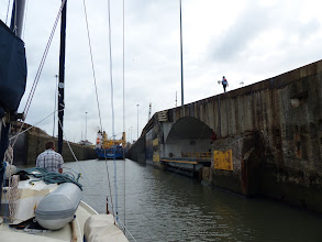 Photo: The handler onshore walks the messenger line ahead as we proceed into the lock.