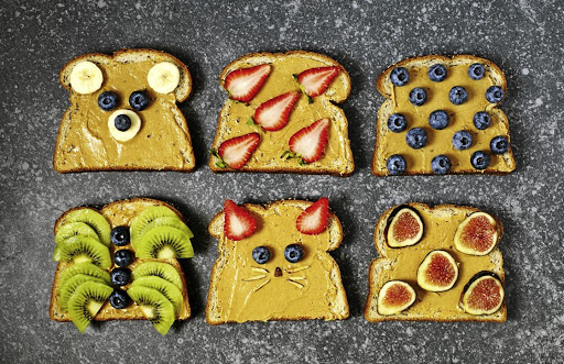 Paint pictures with peanut butter and fruit.