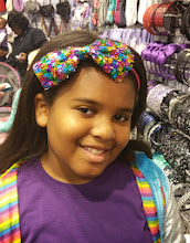 Photo: Kaleya tries on a headband at Claire's