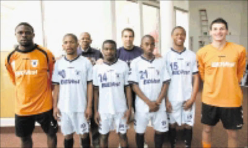RECRUITS: Bidvest Wits' manager George Mogotsi, back left, and coach Roger de Sa welcome new players, from left, Energy Murambadoro, Brian Kgafane, Clifford Mulenga, Patrick Phungwayo, Phikolethu Spelman and Darren Keet. Pic. Veli Nhlapo. 17/07/08. © Sowetan.