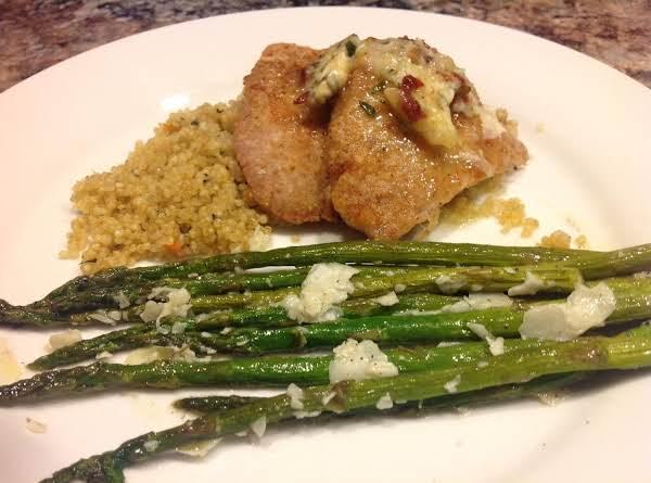 Pan Sauted Pork Loin Served With Quinoa & Roasted Fresh Asparagus.
