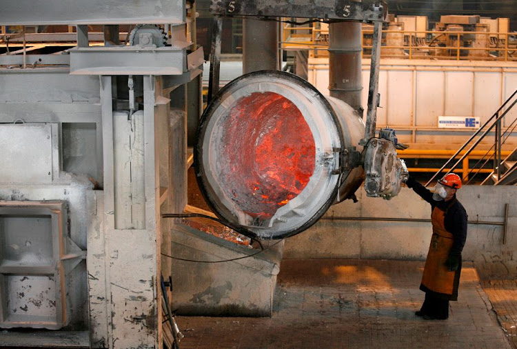 A worker operates a mixer of fused aluminium at the foundry shop of the Rusal Sayanogorsk aluminium smelter outside the town of Sayanogorsk in Russia. File photo: REUTERS