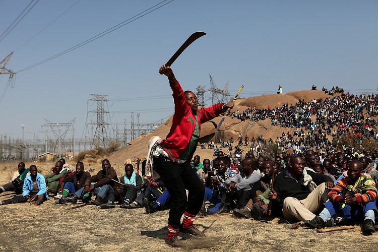 Striking Marikana miners assemble prior to the police shooting when 34 were killed in this 2014 file photo. Picture: SOWETAN