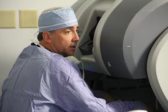 Photo: Sarasota Memorial General Surgeon John Nora, MD working on the daVinci robot.