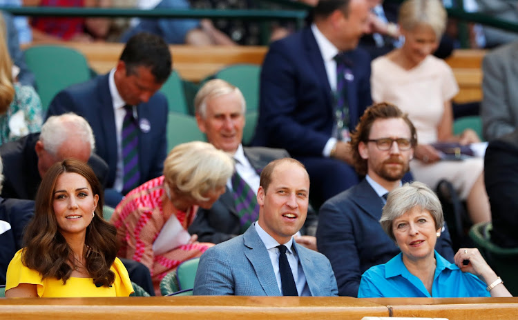 The Duke and Duchess of Cambridge, with UK Prime Minister Theresa May, watch Sunday's men's final at Wimbledon. The actor Tom Hiddleston is in the row behind them.