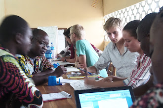 Photo: Discussion at a May 2013 West Africa SRI Training of Trainers held in partnership with the United States Peace Corps in Oueme, Benin. [Photo by Devon Jenkins, Benin, 2013]