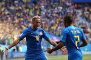 Neymar Jr of Brazil celebrates with teammate Douglas Costa after scoring his team's second goal during the 2018 FIFA World Cup Russia group E match between Brazil and Costa Rica at Saint Petersburg Stadium on June 22, 2018 in Saint Petersburg, Russia.
