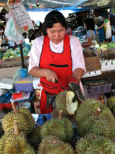 Photo: vendor cutting open a durian