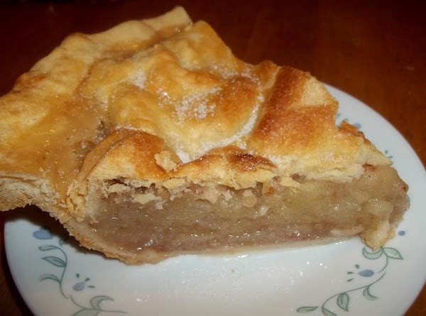 Now, carefully top the apples with the other crust.   Fold top crust under the...