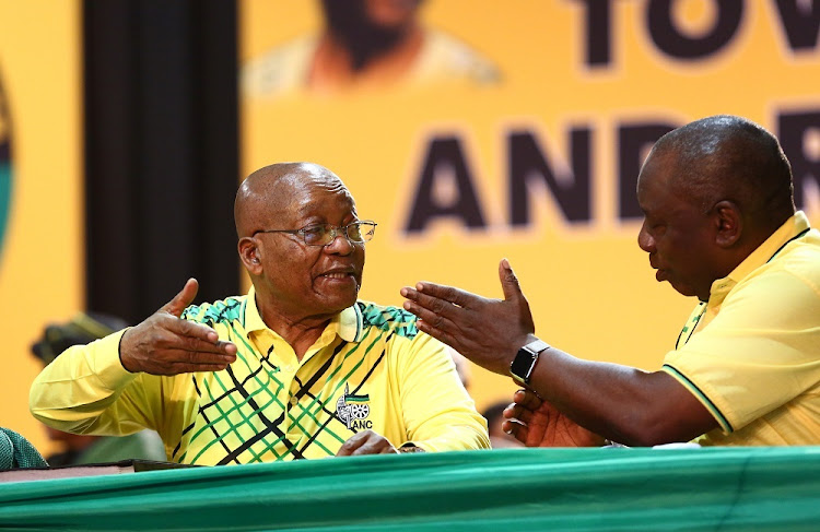 FILE PHOTO: Former ANC President Jacob Zuma and newly elected President Cyril Ramaphosa share a light moment during the 54th ANC National Conference taking place in Nasrec.