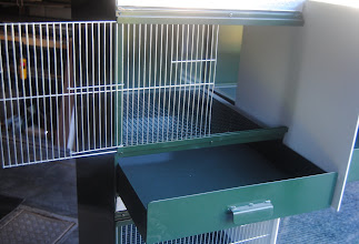 Photo: Frontal view of nursery unit with sliding plastic plate in the middle and one metal frame in the second section for fresh air and easy maintenance.