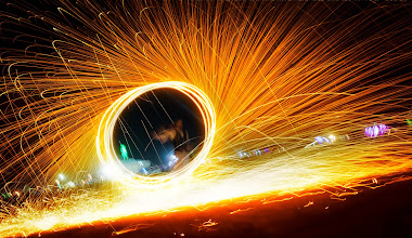 Photo: Spinning Fire at Burning Man  I stopped along the playa when I saw this guy spinning steel wool by himself… It seemed like a waste for someone to do something so awesome without anyone taking photos of it!